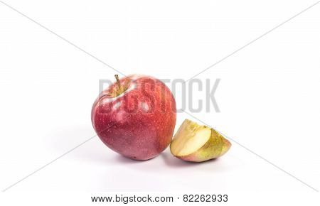 Red apple with one cutted on quarter