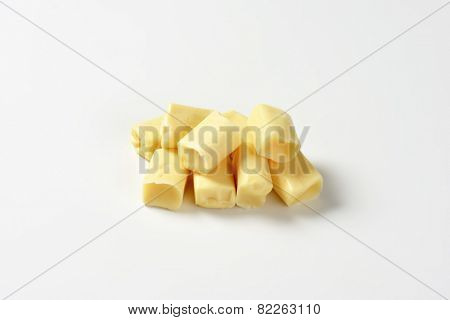 handful of milk toffee candies on white background