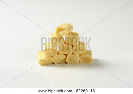 stack of milk toffee candies on white background