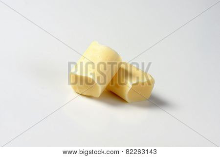 two milk toffee candies on white background