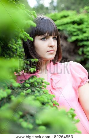 closeup portrait of beautiful young girl in the park