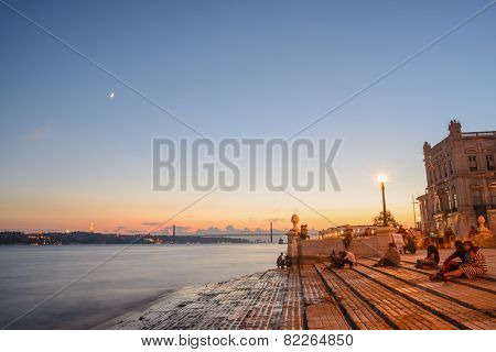 Portugal, Europe - The Columns Wharf Viewpoint at commerce square downtown at sunset in city of Lisbon (long exposure)