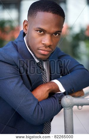 Cool Businessman Posing Outside With Arms Crossed