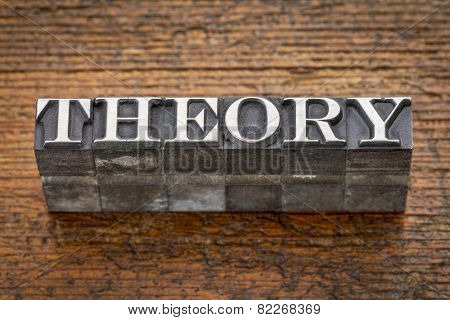 theory  word in mixed vintage metal type printing blocks over grunge wood