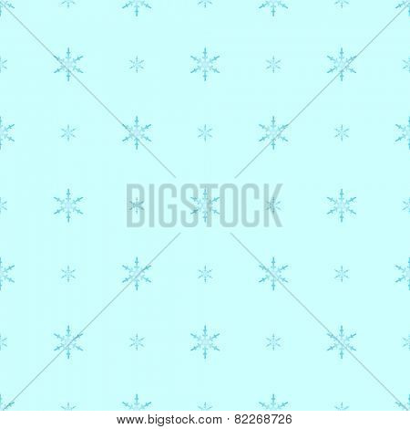 Blue gradient snowflakes in polka dot pattern on cold light cyan, a seamless winter background