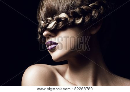 close-up portrait of young woman with creative hairstyle