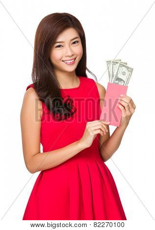 Asian Woman hold red pocket of USD
