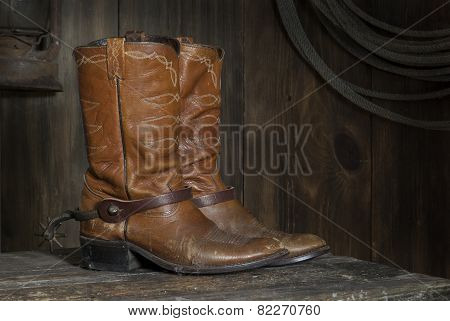 cowboy boots on the shelf in the barn
