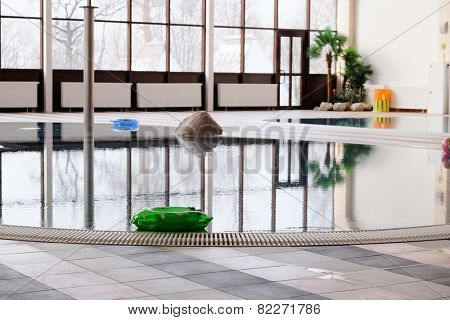 green swimming laps in the indoor swimming pool