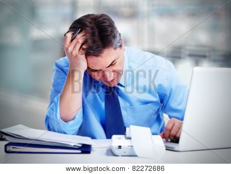 Man having a headache. Stress and depression.
