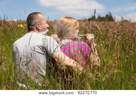 Couple Enjoys An E-cigarette In The Nature