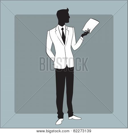 Businessman in modern clothes reads the report