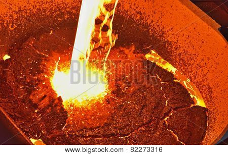Foundry - molten metal poured from ladle