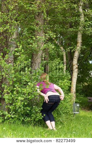 Woman Is Peeing In The Nature