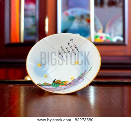 GOMEL, BELARUS - JANUARY 11, 2015: The Japanese porcelain (Sakazuki). Porcelain (also known as china or fine china) is a ceramic material made by heating materials.
