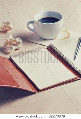 Planning concept, old diary with coffee, papers and pen, vintage filtered