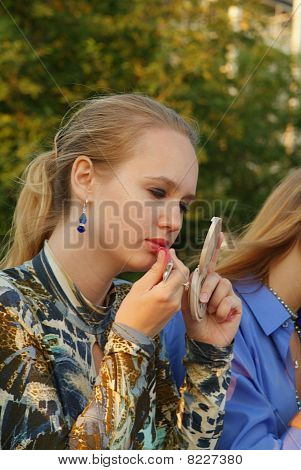 Girls Use Lipstick Outdoor