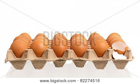Cardboard egg box with brown eggs, isolated with clipping path