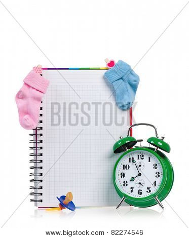 Big green alarm clock with blank notebook, isolated on white background
