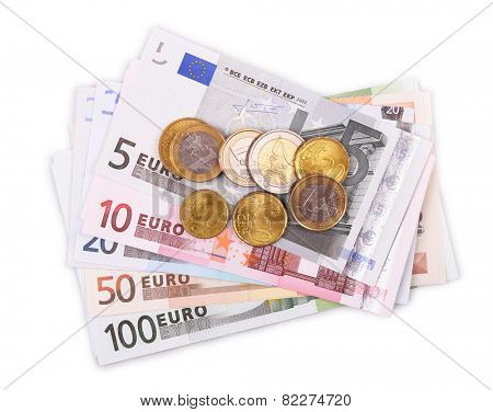 Euro banknotes and coins isolated on white