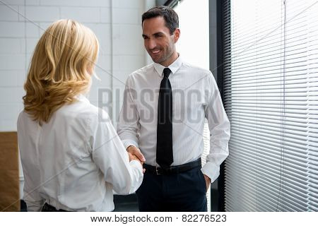 two businesspeople standing up smiling