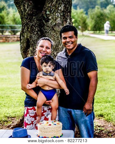 Latino Family And Baby With Birthday Cake