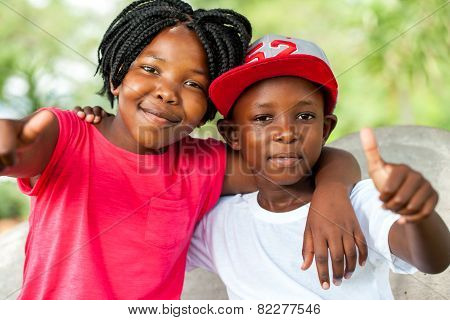 African Brother And Sister Doing Thumbs Up.