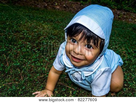 Close Up Of Smiling Baby In Grass