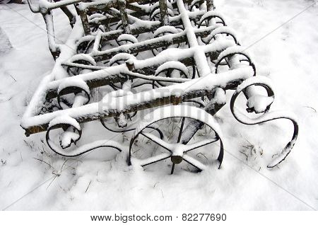 Agriculture Rake On Snow In Farm