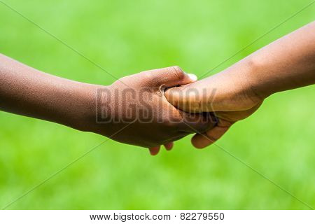 Detail Of African Kids Holding Hands.