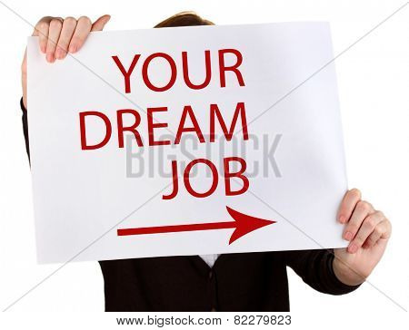 Young businesswoman holding poster with Your Dream Job text on it