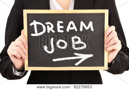 Young businesswoman holding blackboard with Dream Job text on it