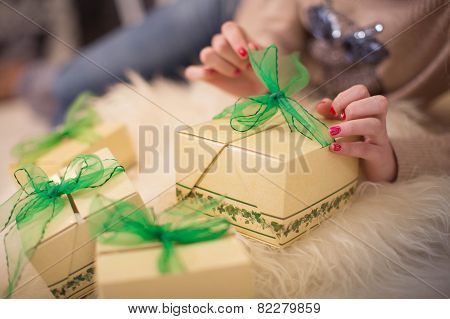 Womanish hands are opened out by boxes with gifts