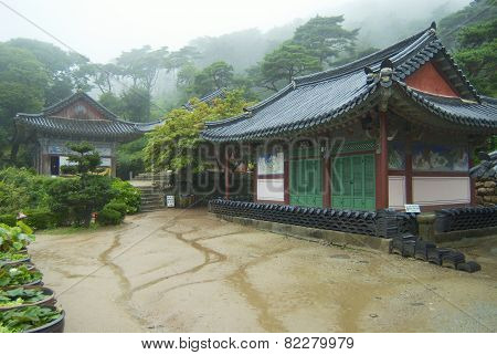 Exterior of the Jeondeungsa temple buildings on a rainy day in Incheon, Korea.