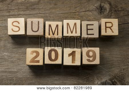 Summer 2019 on a wooden background