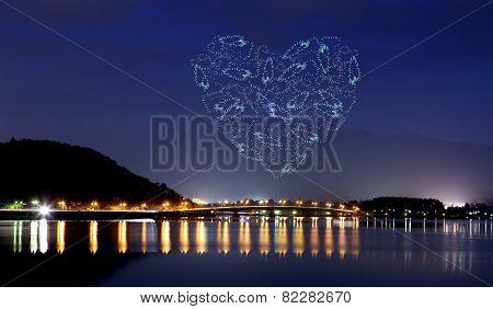 Heart Sparkle Fireworks Celebrating Over Bridge Of Lake Kawaguchiko At Night