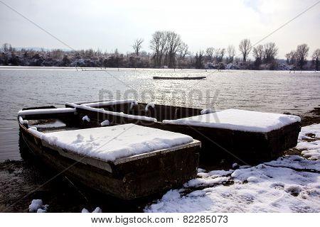 Abandoned Boat Frozen In A Lake