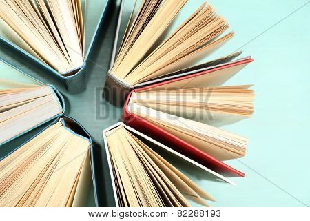 Group of books on colorful background, top view