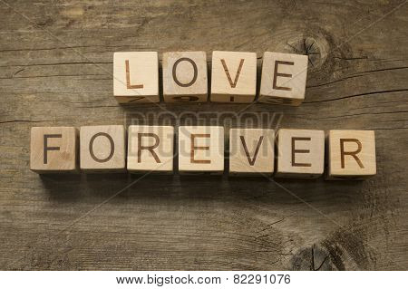 love forever text on a vintage cubes on a wooden background