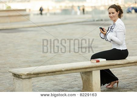Business Woman On Bench
