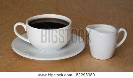 Coffee cup and milk jug