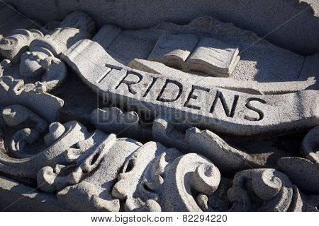 ANNAPOLIS, MARYLAND- DECEMBER 27, 2014: A close up view of the Latin word Tridens carved into a piece of granite from a US Naval Academy building facade that was salvaged.