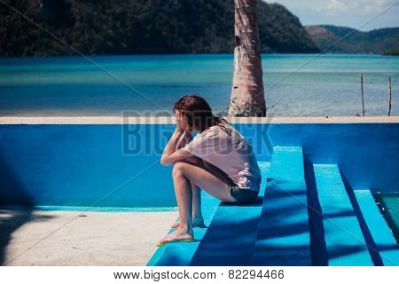 Sad Woman In Empty Swimming Pool