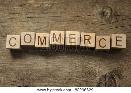 Commerce text on a wooden background