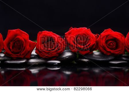 Four red rose and therapy stones