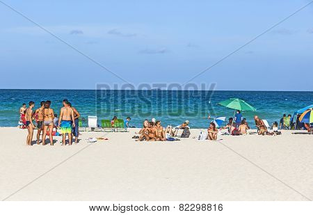 People Enjoy The Afternoon Light At South Beach