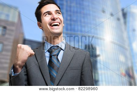 Happy businessman obtaining a promotion