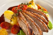 foto of roast duck  - Roasted duck in slices with port wine sauce - JPG