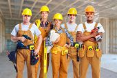 picture of carpenter  - Group of professional construction workers in  new house - JPG