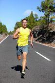 stock photo of sprinter  - Runner man running sprinting for success on run - JPG
